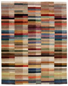 Spectrum rug by The Rug Company as seen on Hollywood Game Night. Wish I could afford this!