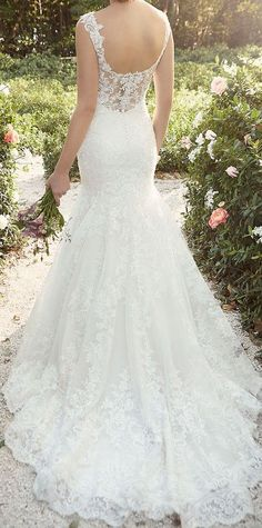 This gorgeous lace over satin wedding dress was inspired by the fashion houses of Europe. Love it!