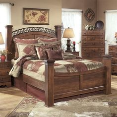 Ashley Timberline Wood Queen Poster Panel Bed in Warm Brown