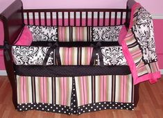 Kate Pink Baby Bedding  This is a modern custom 3 pc crib bedding set.   It includes a black and white damask, polka dot, stripe, and soft hot pink minky bumper.  The coordinating blanket features a cuddly soft minky backing and edge. The crib skirt is a tailored box pleat with a polka dot pleat and border.