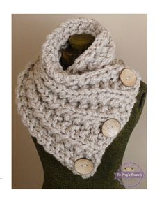 This hand knit chunky button scarf is made of soft and thick tan yarn. The yarn is doubled for extra warmth and the scarf is knit with intricate