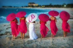 Hot pink bridesmaid dress with hot pink parasol.   Google Image Result for http://www.contemporarybride.com/blog-images/umbrella_tommy_colbert.jpg