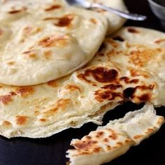 Easy No-Yeast Naan, made on the stove top. It's so fluffy and delicious ... You can brush it with melted butter for Butter-Naan or rub it with garlic halves for Garlic-Naan. For recipe search the blog or see 1st comment.