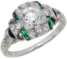 Art Deco platinum, diamond, emerald, and onyx engagement ring, filigree, gallery