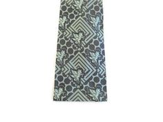 Gorgeous mens novelty vintage 50s square end mens necktie in perfect condition and ready to wear ~ measures 2 1/2 wide and51 long ~ Labeled Wembley (Golden House) ~ Silk ~ Design woven (not printed) ~ color is teal blue green ~ a very specialgift item for him for any ocassion