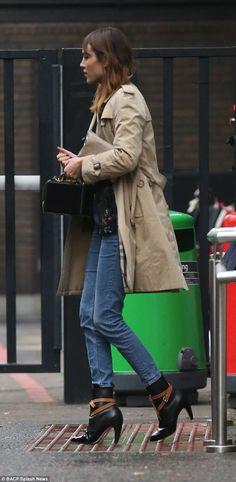 Alexa Chung in Burberry coat, Louis Vuitton boots, Mark Cross bag - In London.  (November 2014)