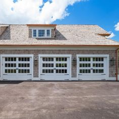 These beautiful custom garage doors (for new home construction by Period Restoration in St. Louis Mo) are not only gorgeous, they're low maintenance with state-of-the-art technology too. | Project Credits: ProLift Garage Doors of St. Louis | Photo Credits: Period Restoration St. Louis Mo Carriage House Garage Doors, Custom Garage Doors, Garage Door Design, Custom Garages, Old Garage, New Home Construction, Art And Technology, Restoration, New Homes