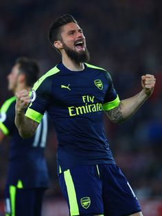 Olivier Giroud Photos Photos - Olivier Giroud of Arsenal celebrates scoring his team's second goal during the Premier League match between Southampton and Arsenal at St Mary's Stadium on May 10, 2017 in Southampton, England. - Southampton v Arsenal - Premier League