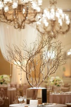 I love most anything with branches! Romantic Ballroom Wedding from Binaryflips Photography. To see more: http://www.modwedding.com/2014/04/24/romantic-ballroom-wedding-florida/