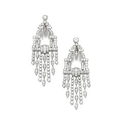 Pair of diamond earrings, 1930s and later Each of geometric tassel design, set with circular-cut and baguette diamonds SOLD. 32,500 GBP