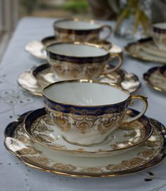 Antique Aynsley tea cup trio in White with Cobalt and Gold Pattern with Gold rims and on handle