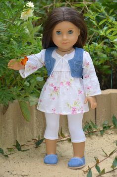 The set includes Blouse , Tights, Denim vest and shoes to fit American Girl and similar 18-inch dolls.  Blouse has 4 snaps at the back .