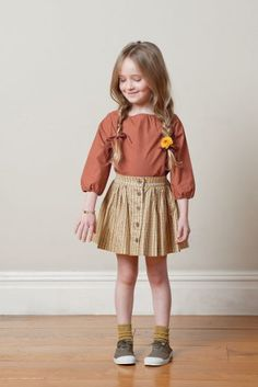 Love everything about this outfit! Especially digging the skirt and socks.