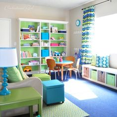 lots of great playroom ideas (and sources) here. I like the idea of painting the back of the shelf, and the world map. Green and blue seems like a good color theme...