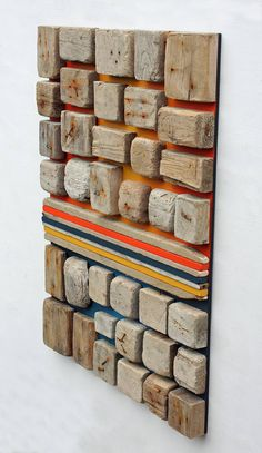 Wood wall art title: Palette The sea will not stand for straight edges and corners for long. These weathered mosaic faces were once the blocks that make up part of everyday pallets. Once their use as pallet blocks was over they found their way into the sea, here they were carved by