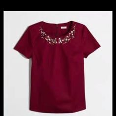 J Crew jeweled neckline short sleeve blouse. EUC Beautiful burgundy top with clear and burgundy jewels. Back zipper. In like new condition no damage or defects. 98% cotton and 3% spandex. The 1st photo is stock. J. Crew Tops Blouses