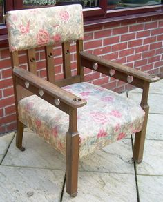 An oak Arts & Crafts armchair made circa 1900 and ascribed to Liberty & Co. This armchair is a rare find as it is in original unrestored condition with original Liberty fabric upholstery