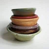 pottery - my pottery looked nothing like this.  Everything I have made looks either like a mushroom or some flat oval type thing.  I guess I need to pinch my pinch pots a little better.