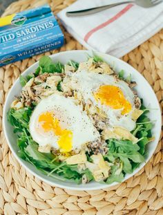 Seaside Breakfast Salad -- A quick and simple low-carb paleo breakfast recipe with sardines, artichokes and eggs, baked and served over fresh arugula.