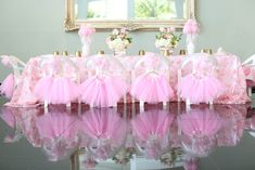 Tutus hung on each little guest's chair for a ballerina themed birthday party! Viviana's Tu-Tu Cute Celebration- {A Ballerina Themed First Birthday Party}