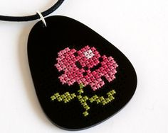 Cross Stitch Embroidery Necklace, Black Acrylic with Antique Pink Flower Design. $45.00, via Etsy.