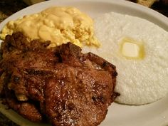 Skillet fried pork chops in olive oil w/ grits & scrambled eggs w/  2 cheeses.  Quick & easy filling B.P.M. . B4 Payday Meal.  ; -  )
