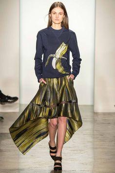 Ostwald Helgason Fall 2014 RTW. #OstwaldHelgason #Fall2014 #NYFW Warholian banana graphic sweater. metallic watercolor painterly waterfall skirt with sheer insert.