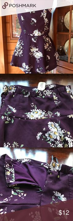 Forever 21 Romper Plum floral with side zip closure, elastic back and shorts under a flirty skirt.  This has been in the closet for a while, but NWT. Forever 21 Dresses