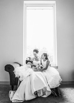 Sweet moment: flowergirls gathered around the bride | Photo by http://bakephotography.com