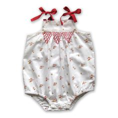pure baby felicite bodysuit, smocking and bows and floral print.
