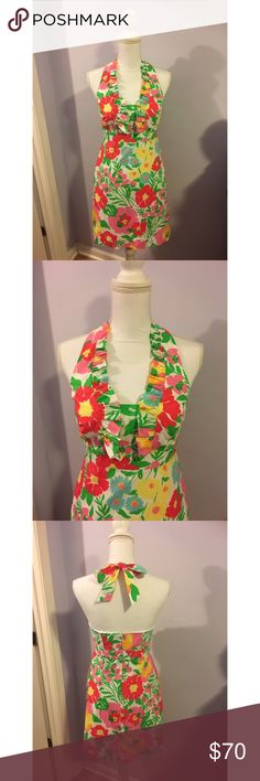 """LILLY PULITZER Lavin Dress in """"Garden By The Sea"""" Lilly Pulitzer Lavin dress in Resort White """"Big Garden by the Sea"""". Size 4. Beautiful halter dress with a ruffle top and tie back neck. Fully lined with a built-in bra and POCKETS!! Shell and lining both 100% cotton. Excellent pre-owned condition! No stains or holes. Lilly Pulitzer Dresses"""