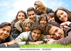 stock photo : happy group of friends smiling outdoors in a park
