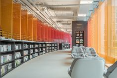 wutopia lab's metal rainbow bookstore welcomes visitors with a succession of colorful panels