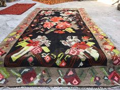 Kilim Rug from Karabag Region of  Caucasia  . It is about 55years old, completely hand woven. It is wool on wool and the wool is completely hand-spun. It's  a central Caucasia rug and  with flower designs .                It is totalIy clean and in perfect condition; ready to use.  Dimensions: 5' x9'8'' ft /2.95 x1.55 mt Stock Number: 391