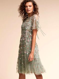 If you're going to an outdoor spring evening wedding, embrace the garden feel with a dress that looks just like one. With its beaded florals, the sage-hued Bobbi Dress is a delicate showstopper.