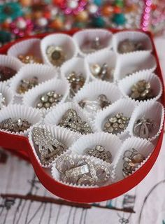 "Organize your jewelry in a repurposed chocolates box, as seen @auntpeaches. Peaches decorates the outside with ""free jewelry"" from Mardi Gras! http://thestir.cafemom.com/home_garden/188688/17_genius_gorgeous_diy_jewelry"