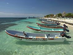 i loooooved PUERTO MORELOS MEXICO!!! so beautiful. 2nd largest reef. about 45 mins south of cancun. small, sweet, gorgous fishing town in mexico. ppl are friendly. take AIO bus to puerto morelos...easy. its a must. i want to retite there!