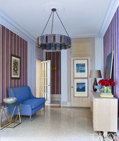 The foyer's bronze light fixture is custom made, the lithographs are by Wilson Harding Lawrence, the wallcovering is by Designers Guild, and the mosaic tile flooring is original.   - ELLEDecor.com