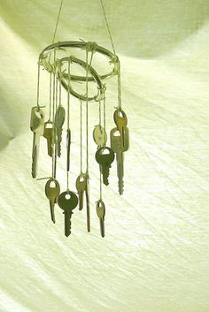 Whimsical Wind Chime: Loop keys with lengths of craft wire, jute, or ribbon and hang from a hoop ring, or repurpose an old cheese grater or funky metal strainer or sieve for a really cool look. Source: Flickr user orangesparrow