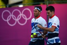 LONDON, ENGLAND - JULY 28:  Colin Fleming and Ross Hutchins of Great Britain play against Julien Benneteau and Richard Gasquet of France during their Men's Doubles Tennis match on Day 1 of the London 2012 Olympic Games at the All England Lawn Tennis and Croquet Club in Wimbledon on July 28, 2012 in London, England.