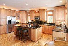 K.G. Stevens- Home remodeling ideas! Black granite countertops with light wood cabinets.