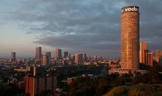 A landscape view of the city of downtown Johannesburg, featuring the Ponte Tower.
