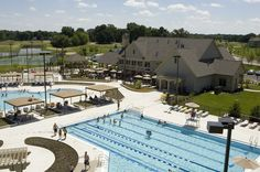 Two resort-style pools and tennis courts flank the Community Center. Highland Woods by Crown Community Development in Elgin, Illinois