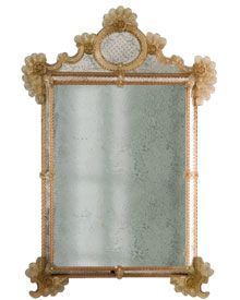 antique Venetian mirror framed in hand-etched glass with antiqued gold highlights, trimmed with glass ribbons and rosettes