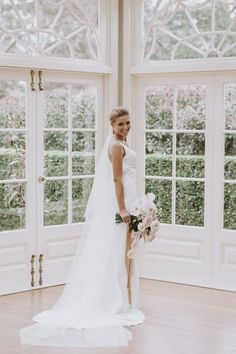 This gorgeous modern bride in her dress from Chosen by One Day in our sun drenched, glass pane Conservatory - perfect for modern wedding receptions and ceremonies at Gabbinbar Homestead.
