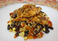 Baja chipotle marinated chicken breasts on top of a rice, bean, and corn mixture make for a simple and delicious Spanish-inspired meal!