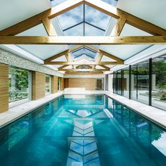 Contemporary pool house by Re-Format brings together stone copper and oak