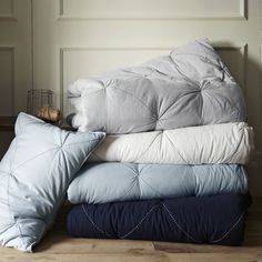 Diamond stitch quilts from West Elm.  Could easily customize a basic comforter with a running stitch in embroidery floss!
