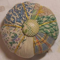 Perky Pincushion green and yellow triangles by christenbrown, $10.00