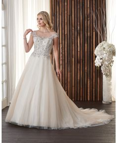 717-This Wedding gown has a luxurious sparkle crystal beading frames the  delicate bateau neckline 48fe60266011